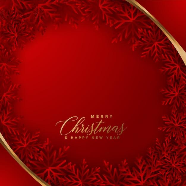 雪片のデザインとエレガントな赤いクリスマスカード 無料ベクター