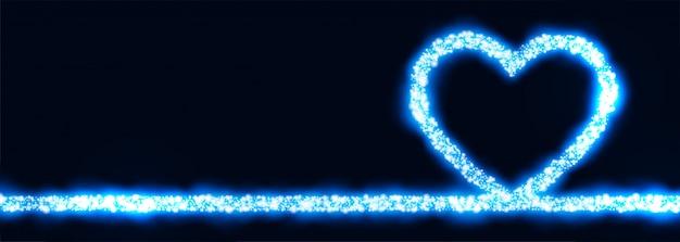 Светящееся синее сердце из сверкающего баннера Бесплатные векторы