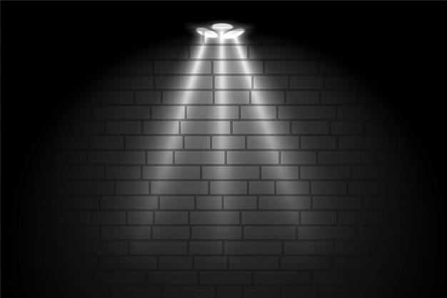フォーカススポットライトの背景を持つギャラリーの黒い壁 無料ベクター