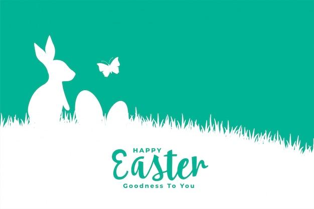 Счастливой пасхи плоский стиль карты с кроликом на траве Бесплатные векторы