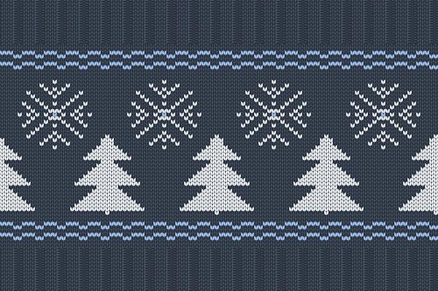 雪の結晶とクリスマスツリーの青、白の色でシームレスな北欧編みパターンをベクトルします。クリスマスと冬の休日の弾性バンド付きセーターのデザイン。平編みとリブ編み。 Premiumベクター