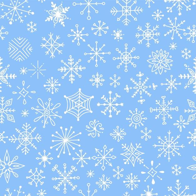 手描きの雪とのシームレスなパターン。 Premiumベクター