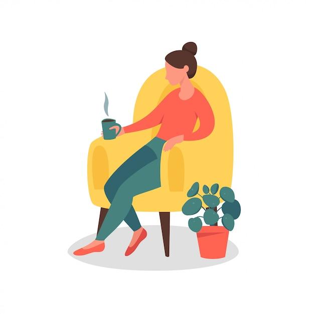 お茶と一緒に家で座っている夢のような女性 Premiumベクター