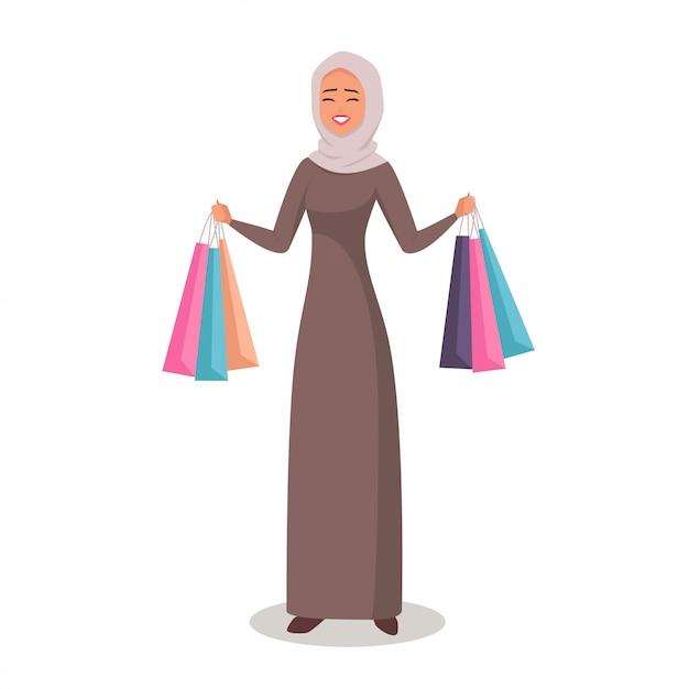 買い物袋を提示するヒジャーブのアラブ女 Premiumベクター