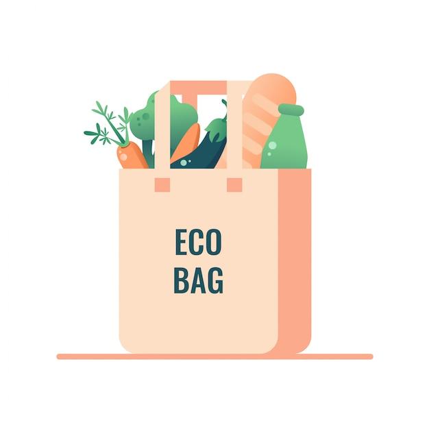 白い背景から分離されたビーガンフード付きの再利用可能な食料品エコバッグ。プラスチックにノーと言う Premiumベクター