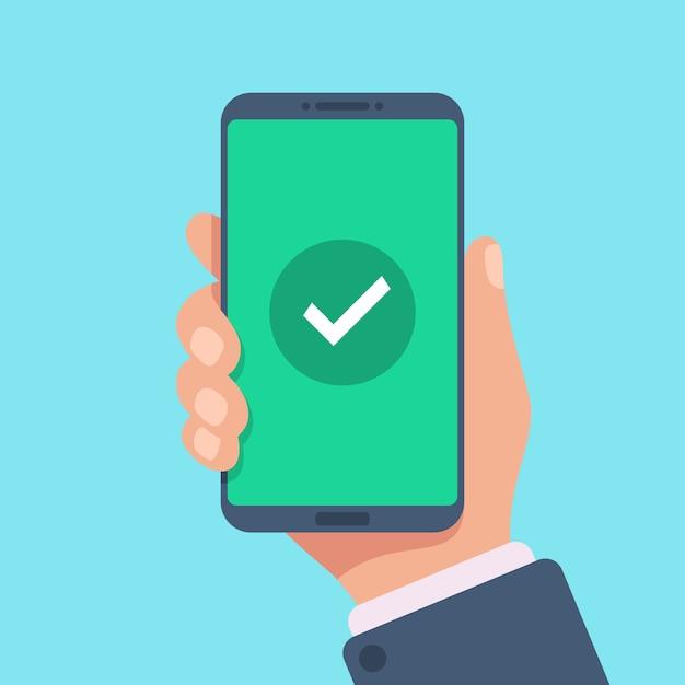 スマートフォンの画面にチェックマークを付けます。 Premiumベクター