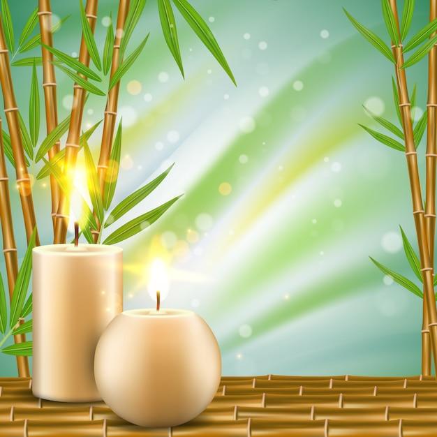 竹とアロマキャンドルでスパの背景 Premiumベクター