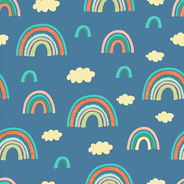 虹、雲と手の手紙とのシームレスなパターンは子供のために良いに焦点を当てる Premiumベクター