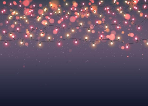 Светящиеся рождественские гирлянды на темном фоне с боке Premium векторы