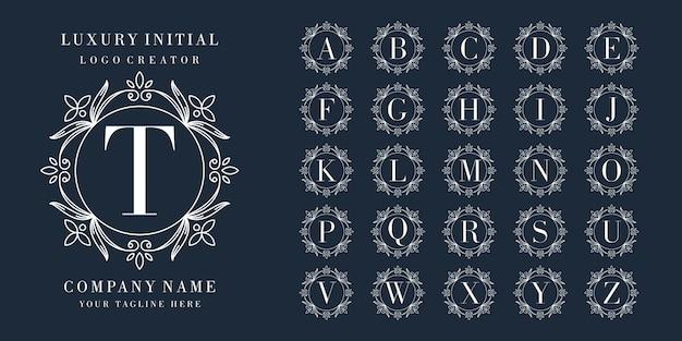 Первоклассный логотип с цветочной рамкой Premium векторы