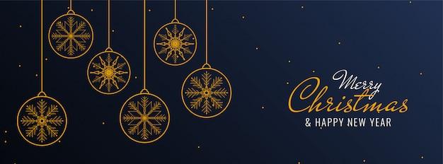 クリスマスボールとメリークリスマスお祝いバナー 無料ベクター