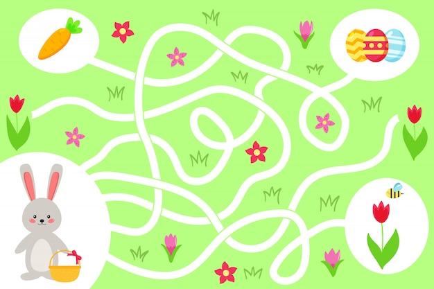 就学前の子供のための迷路ゲーム。かわいいバニーがイースターエッグへの正しい道を見つけるのを手伝ってください。春の花とニンジン。ベクトルイラスト。 Premiumベクター