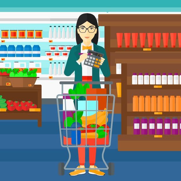 スーパーマーケットで電卓を頼りに女性 Premiumベクター