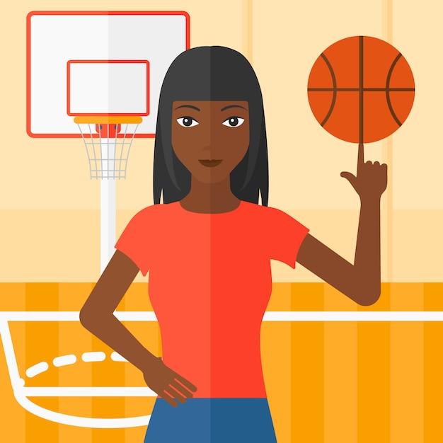 バスケットボール選手の回転ボール Premiumベクター