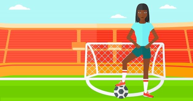 Футболист с мячом Premium векторы