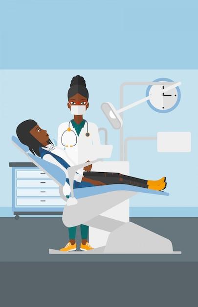 Стоматолог и женщина в кресле стоматолога. Premium векторы