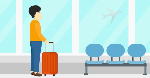 Человек в аэропорту с чемоданом Premium векторы