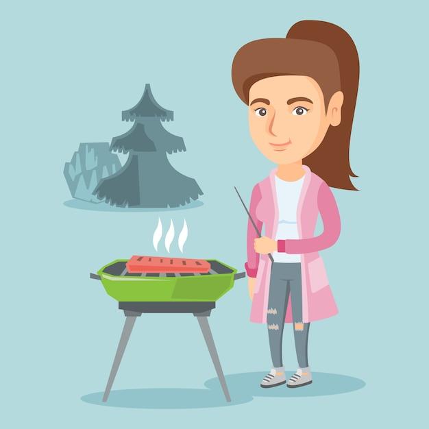 Кавказская женщина приготовления стейка на гриле. Premium векторы