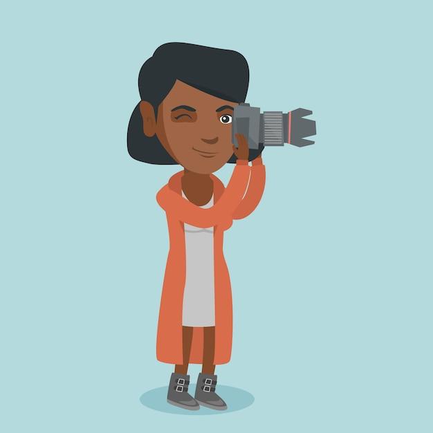 写真を撮る若いアフリカ系アメリカ人の写真家 Premiumベクター