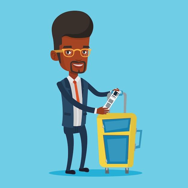 荷物タグを示すアフリカ系アメリカ人のビジネスマン。 Premiumベクター