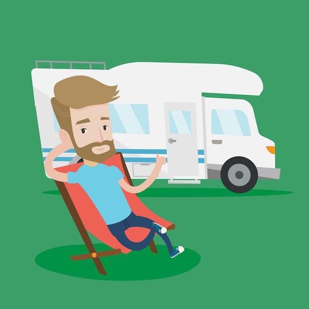 Человек, сидящий в кресле перед автофургоном. Premium векторы
