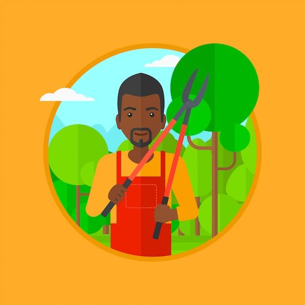 庭のベクトル図の剪定機を持つ農家。 Premiumベクター
