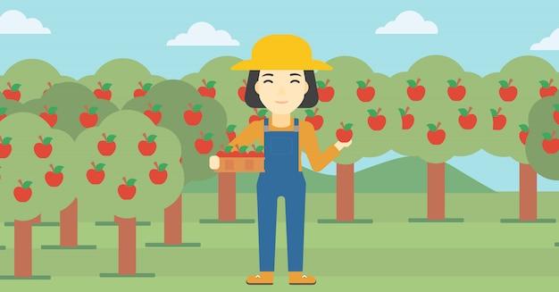 農家の収集りんご Premiumベクター