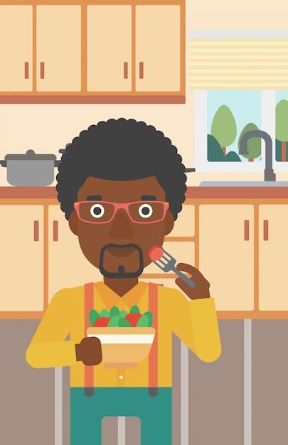 Человек ест салат. Premium векторы