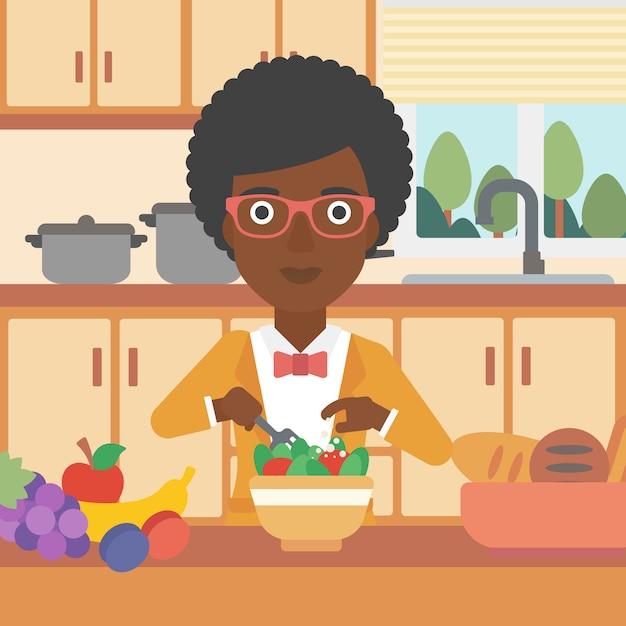 Женщина готовит овощной салат. Premium векторы