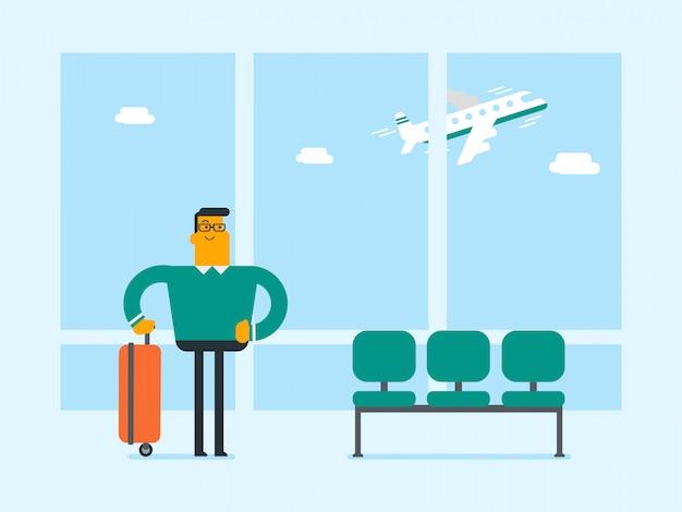 Кавказский человек, стоящий в аэропорту с чемоданом. Premium векторы