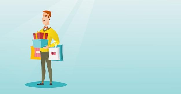買い物袋やギフト用の箱を保持している白人の男 Premiumベクター