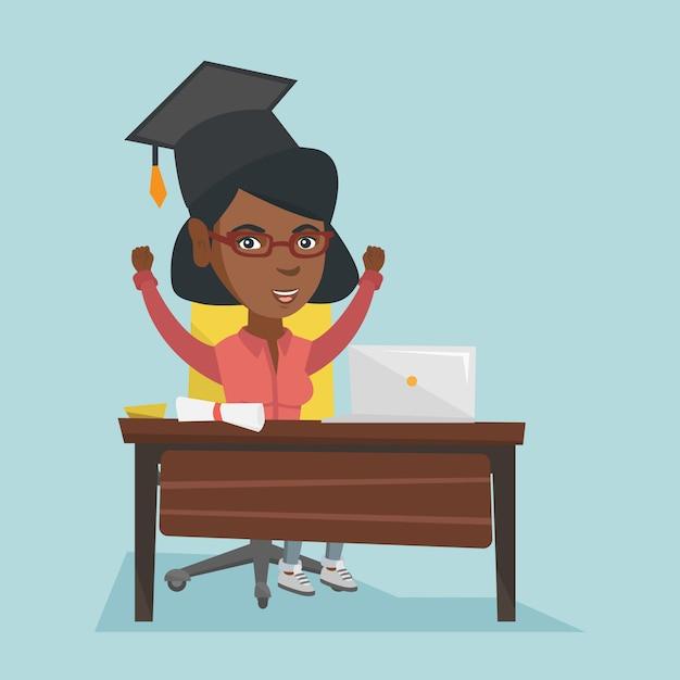 ノートパソコンと卒業証書とテーブルに座っている女の子。 Premiumベクター