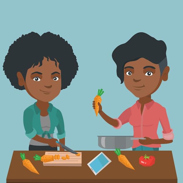 アフリカの女性が健康的な野菜の食事を調理します。 Premiumベクター
