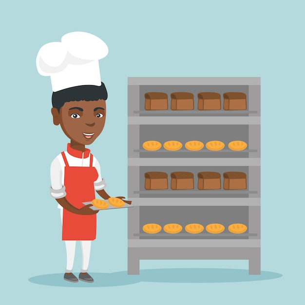 Молодой африканский хлебопек держа поднос с хлебом. Premium векторы