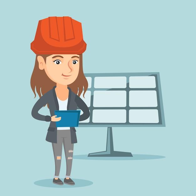デジタルタブレットを使用して太陽光発電所の労働者 Premiumベクター