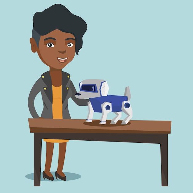 ロボット犬と遊ぶ若いアフリカ人女性。 Premiumベクター