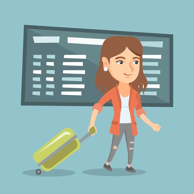 空港でスーツケースを持って歩く白人女性。 Premiumベクター
