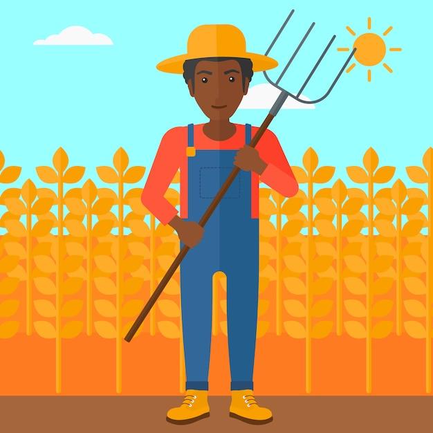 熊手を持つ農家。 Premiumベクター