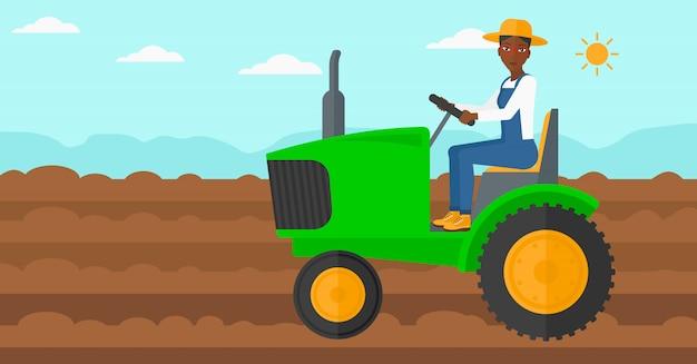 農家の運転トラクター。 Premiumベクター