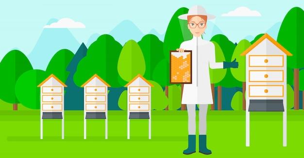 養蜂場の蜂キーパー。 Premiumベクター
