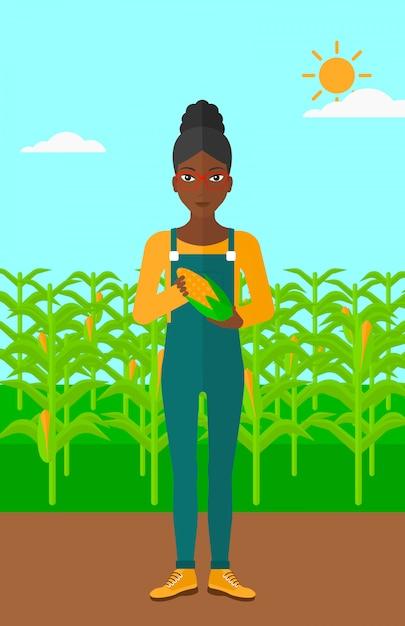 農家持株トウモロコシ。 Premiumベクター