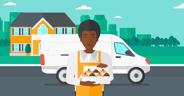 Бейкер холдинг коробку тортов. Premium векторы