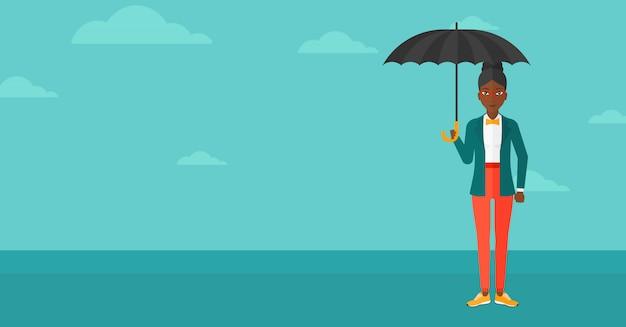 ビジネスの女性が傘で立っています。 Premiumベクター