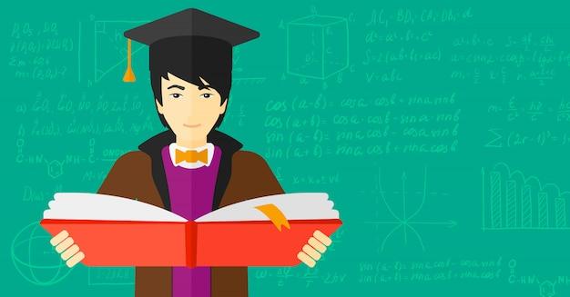 本を持って卒業キャップの男 Premiumベクター