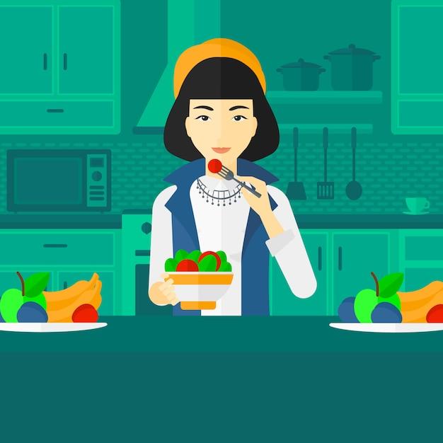 Женщина ест салат. Premium векторы