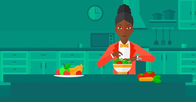 女性が食事を調理します。 Premiumベクター