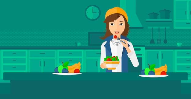 サラダを食べる女性。 Premiumベクター