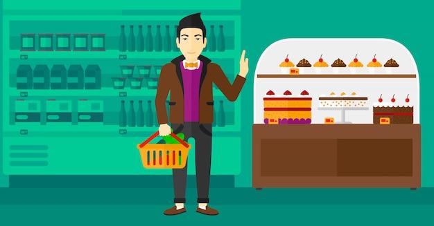 Человек, держащий супермаркет корзина. Premium векторы