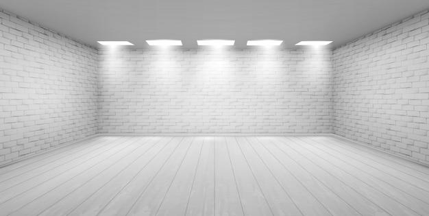 スタジオで白いレンガの壁と空の部屋 無料ベクター