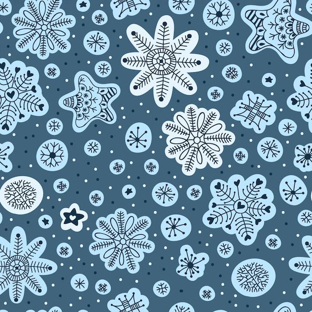 シームレスパターン手描き下ろし雪片 Premiumベクター